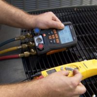 Air Conditioning Contractor doing maintenance check in Slidell, LA